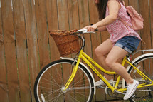a girl riding a bike