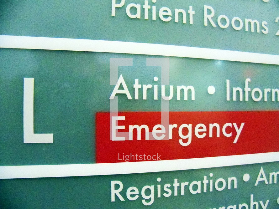 An Emergency Room sign and directory from an area hospital sign directing patients and hospital visitors to the ER where patients are treated for injuries, accidents and sudden illnesses.