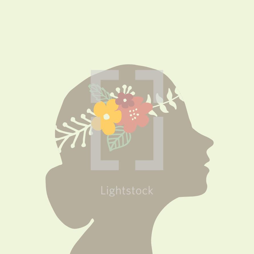crown of flowers in a woman's head