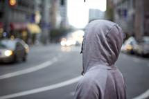 man crossing a busy street