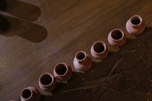 row of clay pottery jars
