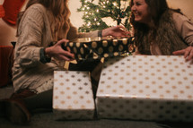 women opening Christmas gifts