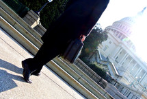 Politician and businessman walking on a sidewalk in Washington DC
