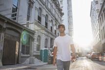 man walking down a city street