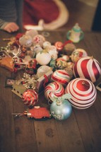 Christmas ornaments lying on wooden table.