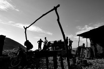 men gathered in an African shanty town