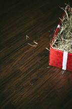 box of straw wrapped in Christmas paper