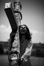Jesus carrying the cross cries out in pain