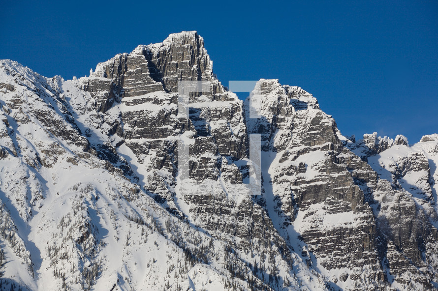 Snow covered mountain cliff