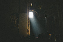 light shining through a window into a Cathedral in Rome