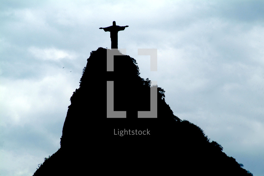 Statue of Jesus on a mountaintop.