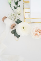 wedding ring, gold, letters, paper, invitations, wedding, roses, pink, flowers, white background, ribbon, spool