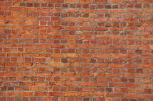 Baked clay red brick wall