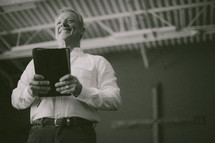 pastor holding a Bible during a sermon