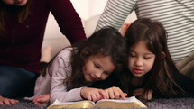 A family reading a Bible together