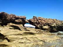large rocks on an ocean shore