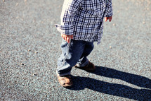 Boy standing on concrete