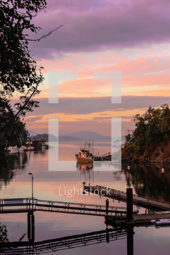 piers across water -  trees -  boats