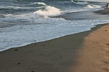 waves crashing onto the shore