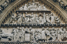 detailed carvings in the walls of Notre Dame