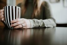 a woman with a striped mug