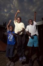 Happy boys jumping and chanting