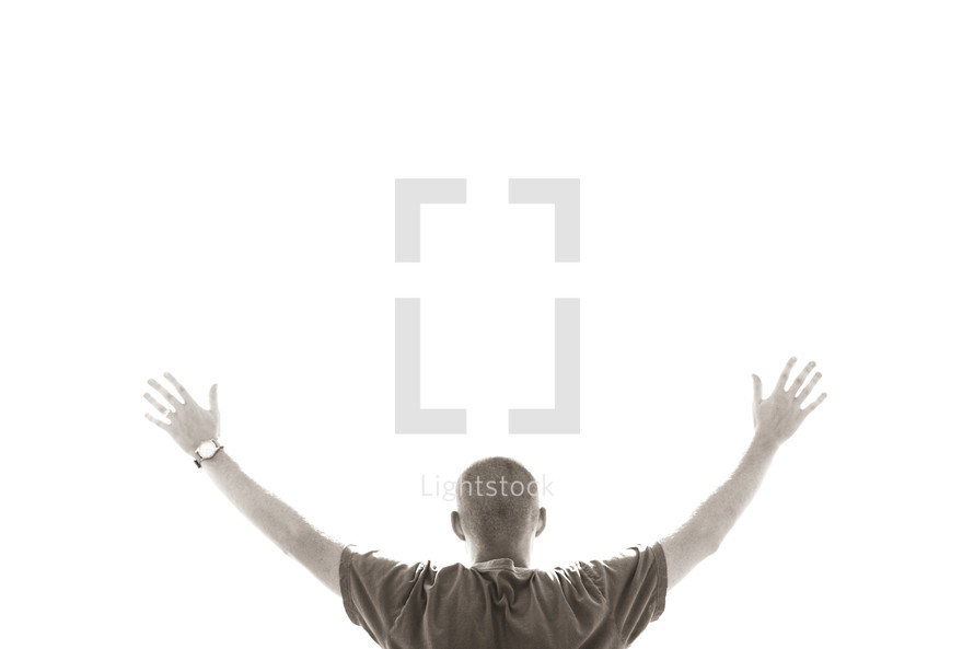 A man with hands raised worshipping - isolated on white