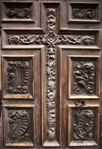 ornate wood door to the sanctuary of one of the San Antonio missions