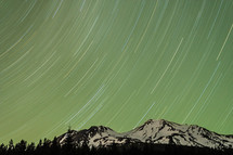 Long exposure of starlights above a mountain
