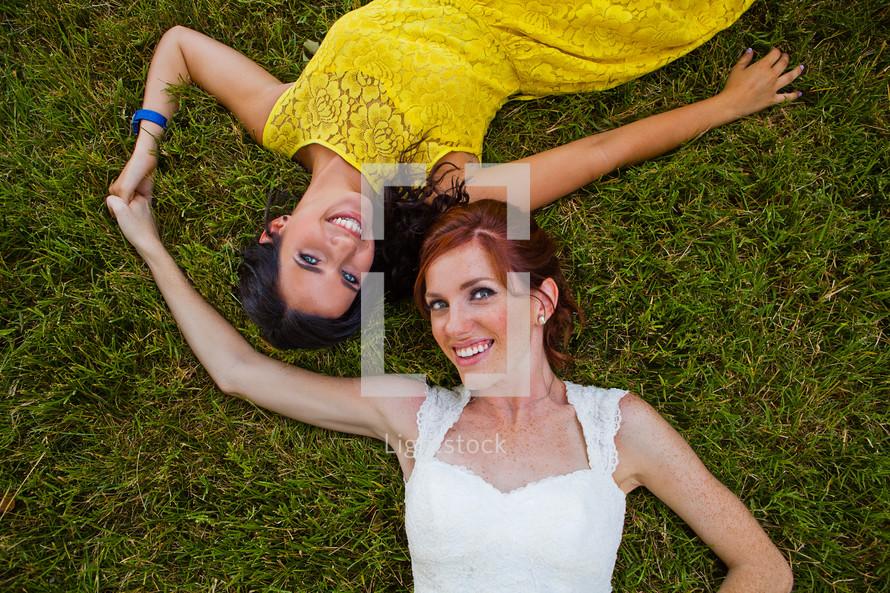 sisters lying the grass
