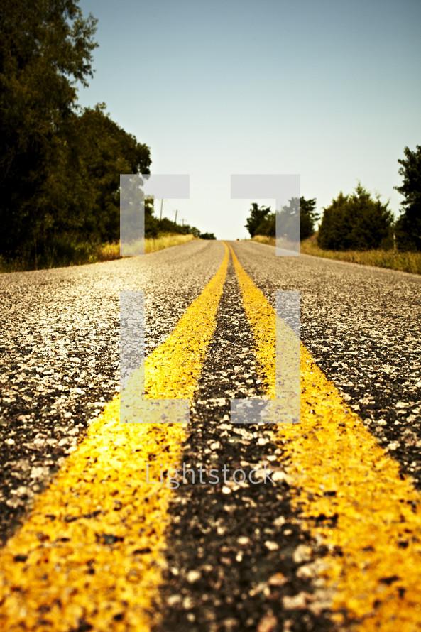Double yellow line on an asphalt road
