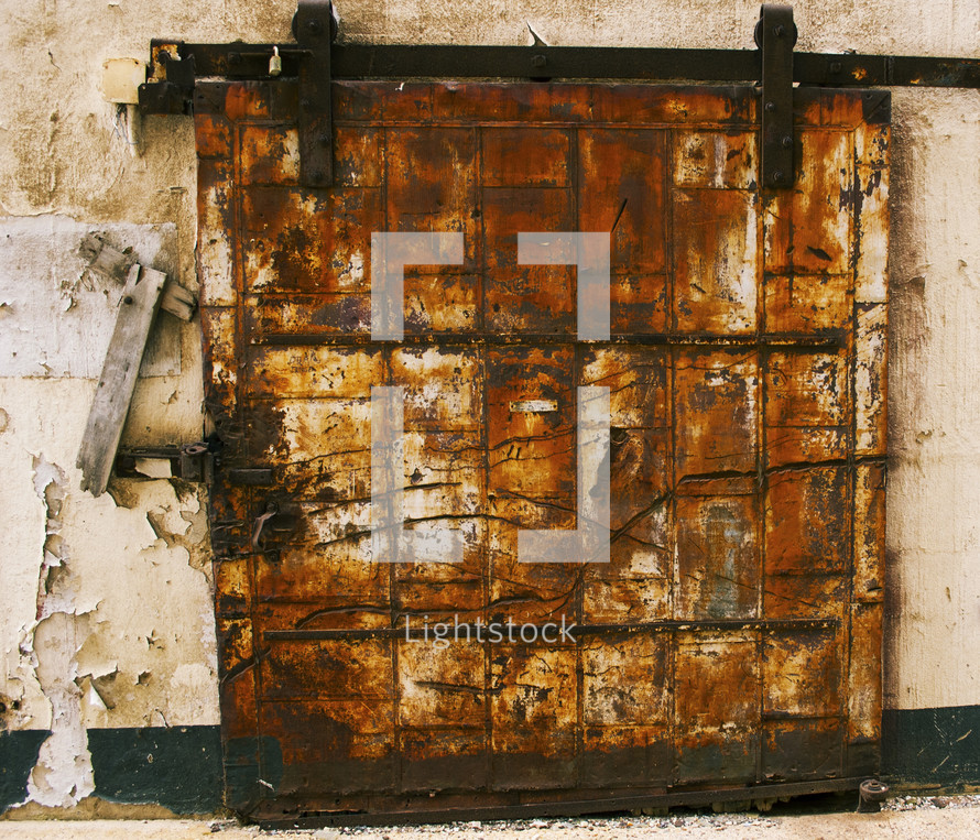 rusted and locked cover over a window