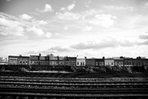 Row houses by train tracks