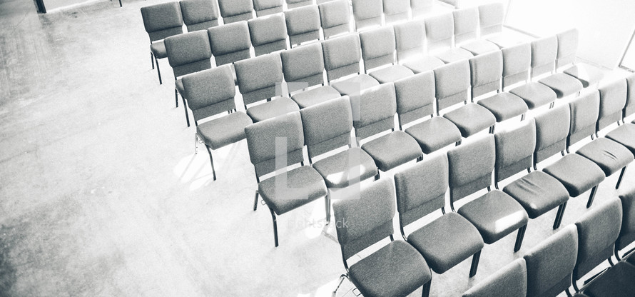 empty rows of chairs in a church