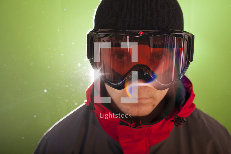 man standing in ski goggles
