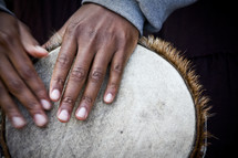 hands on a drum