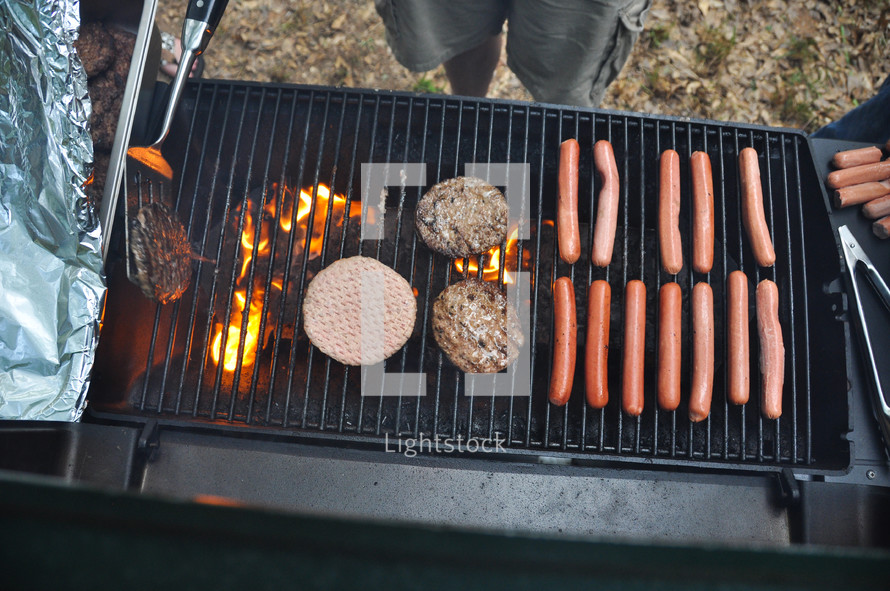 hot dogs and hamburgers on a grill