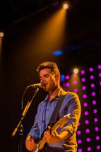 Man singing  worship leader guitar praise