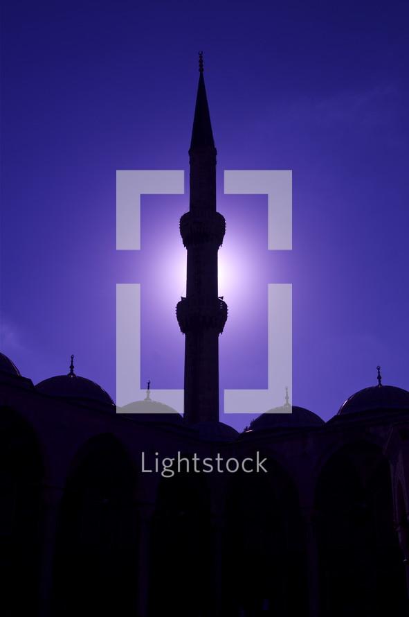 Moonlit minaret at a Muslim mosque.