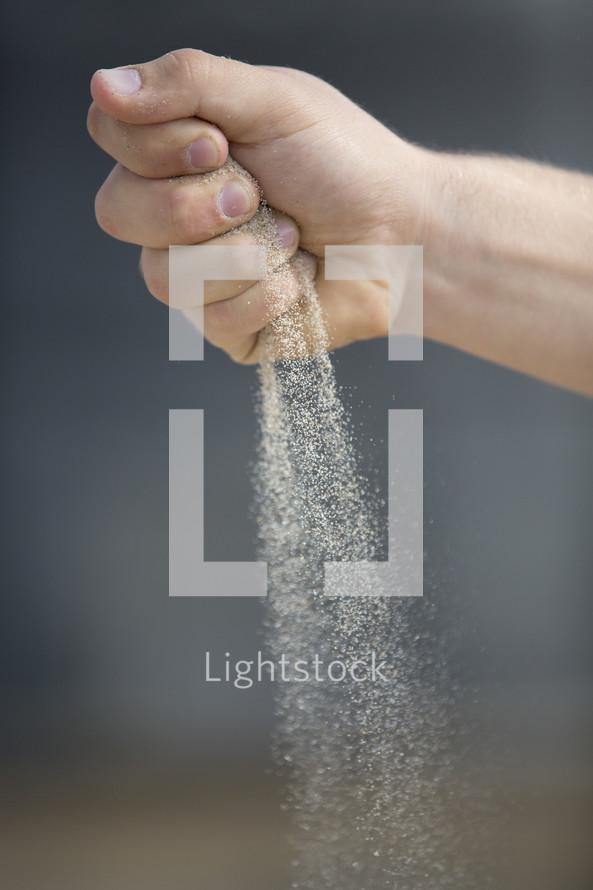 Hand sifting sand