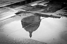 reflection of a dome in a puddle