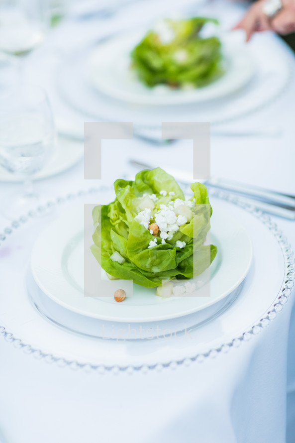 Lettuce and fetta plate salad, place setting, dinner, event, party, serving, saucer, charger