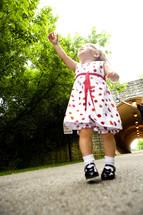 toddler girl reaching for the sky