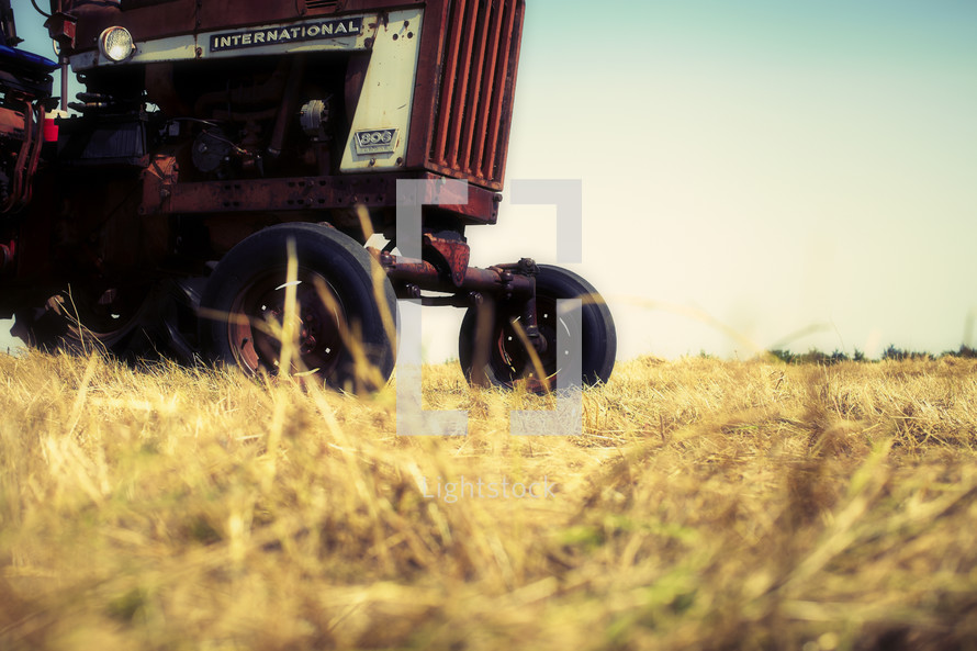 A red tractor in a field