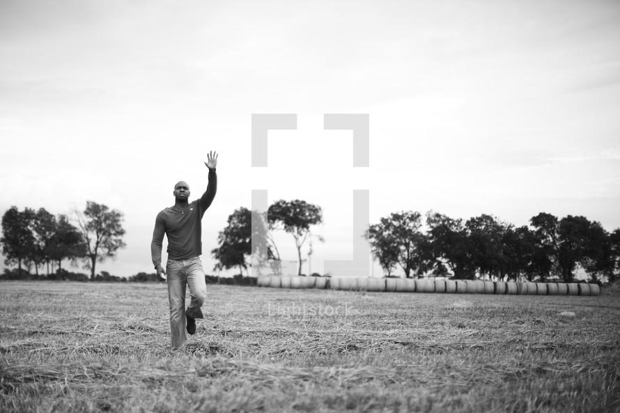 A man raising his hand in worship