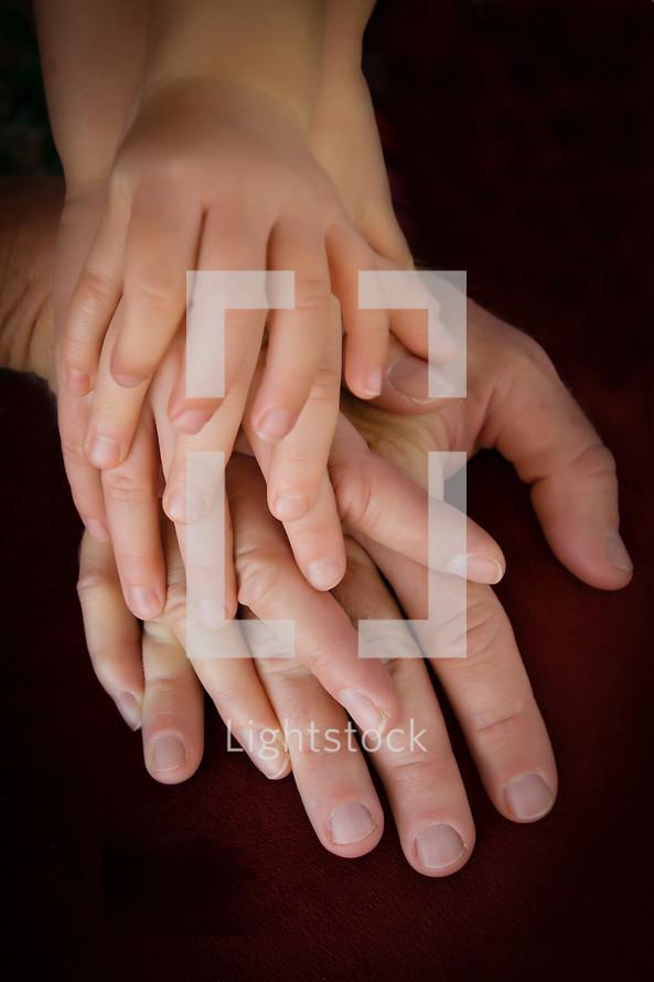 Closeup of families hands