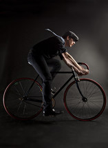 Man riding a bicycle with scarf