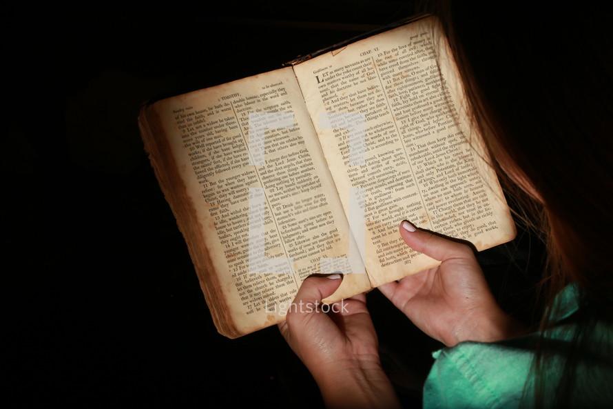 Teen girl reading Bible