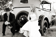 Bride and groom sitting on a vintage classic ford model T car 1920's