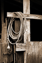 rope in a barn on a wooden cross